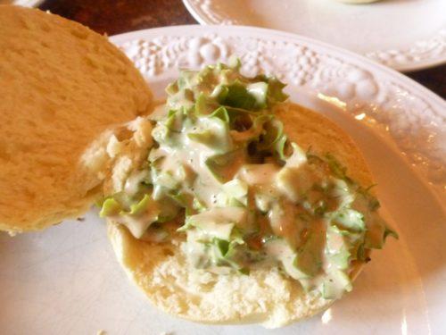 Sauce with salad on bun