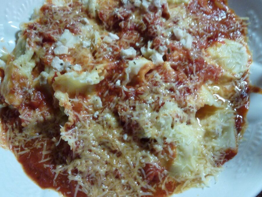 Raviolis served with tomato sauce and cheese