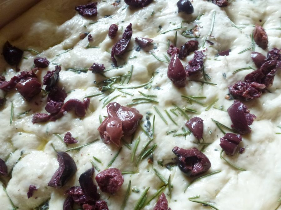 focaccia bread dough with olive toppings