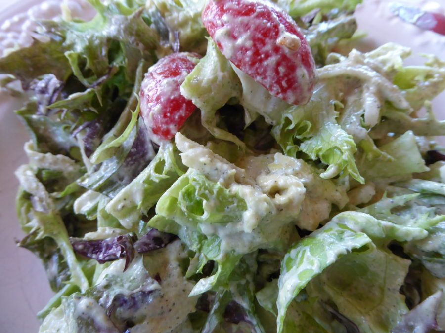 salad tossed with delightful dressing