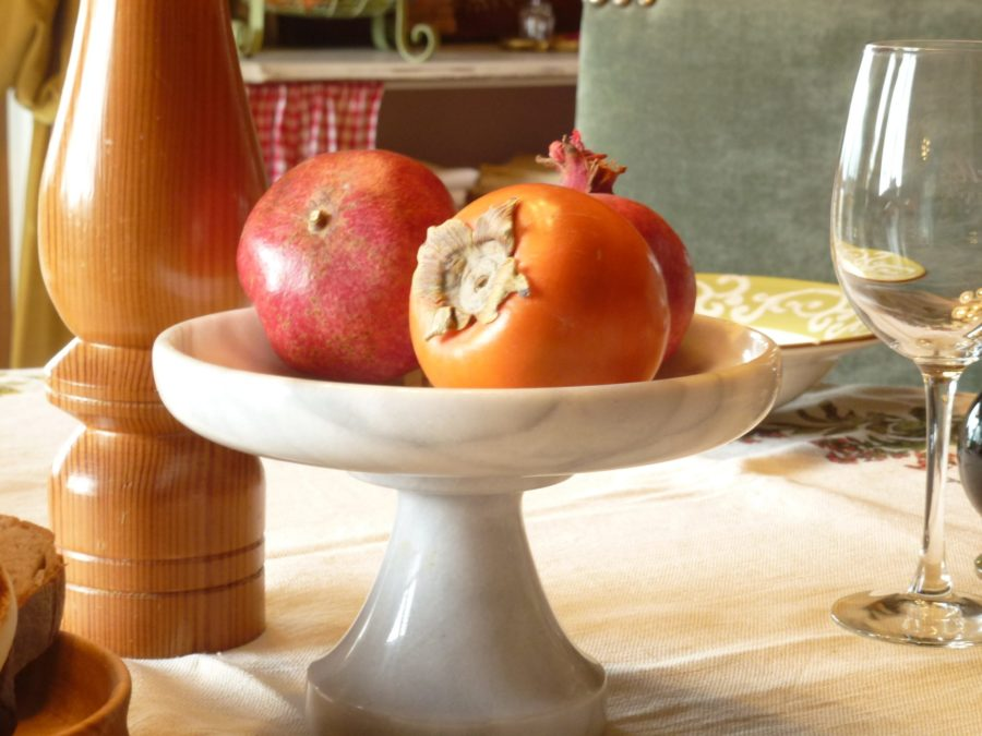 Table with persimmon and pomegranate